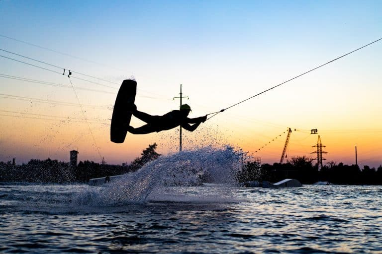 wakeboard. wakeboarding jumping at sunset